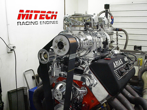 Traditional street blown Chevy engine with 8-71 blower and twin Hollwy carbs